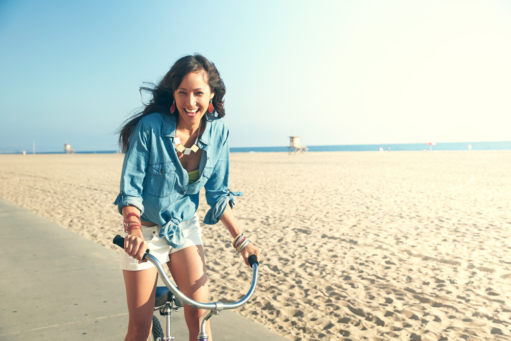 Lifestyle photography Derek Israelsen Girl Bike Beach