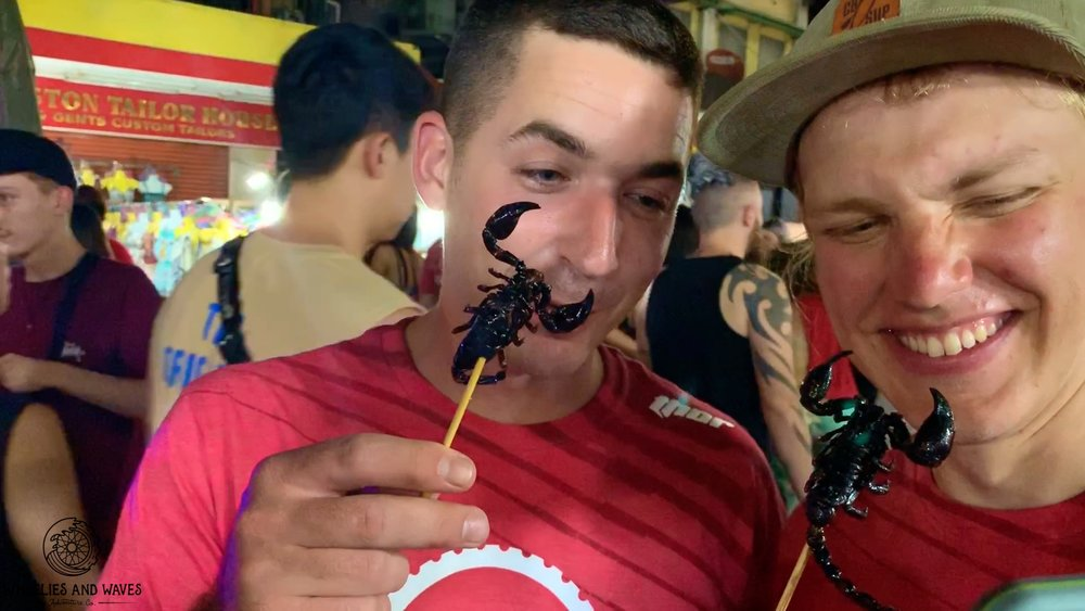eating a scorpion in thailand.jpg