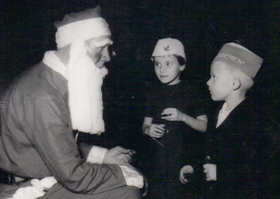 Liz and Steve with Santa on SS Bremen on Atlantic crossing in 1965.