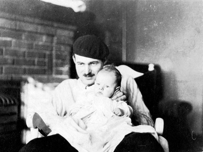 "Hemingway with his first son, John Hadley Nicanor Hemingway, known as ""Bumby,"" in Paris."