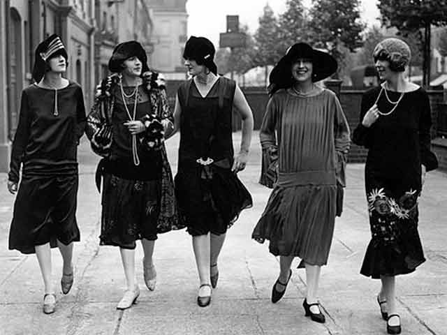 Fashionable women strolling through Paris, 1920s.