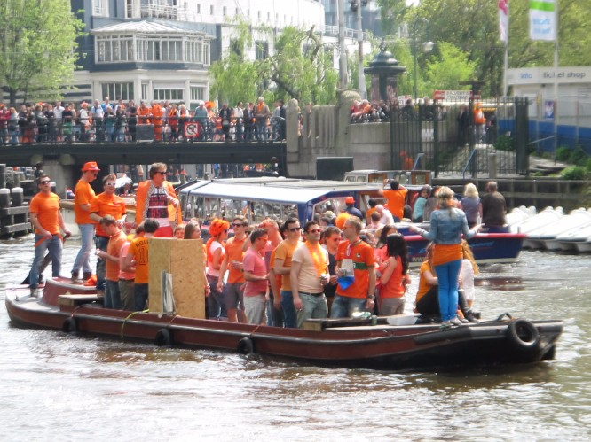 By land and by sea – revelers on King's Day in Amsterdam.
