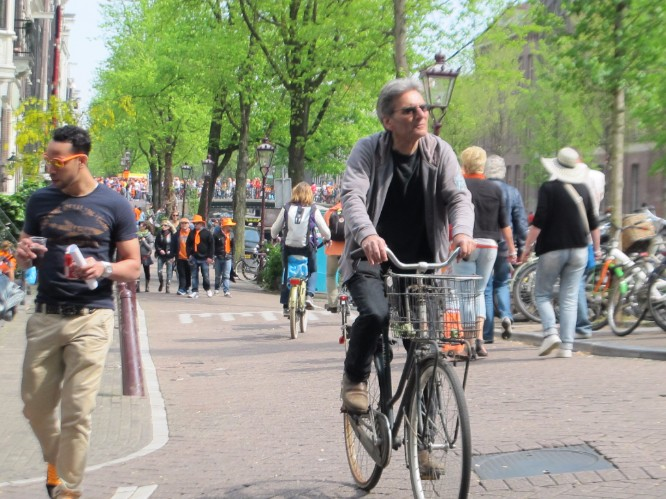 Getting around on King's Day - best to walk, cycle, or boat.