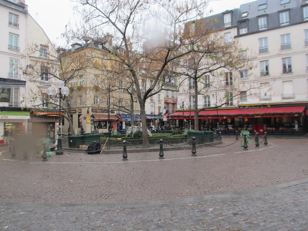 6. La Place de la Contrescarpe, around the corner from Hemingway's first apartment in Paris. He mentions The Cafe des Amateurs, with the red awning, now the Cafe Delmas, in The Sun Also Rises.JPG