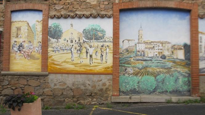 Murals at Saint-Laurent-de-Cerdans showing the dancing of the Sardane (center). Photo: Elizabeth Kemble for Travellati Tours.