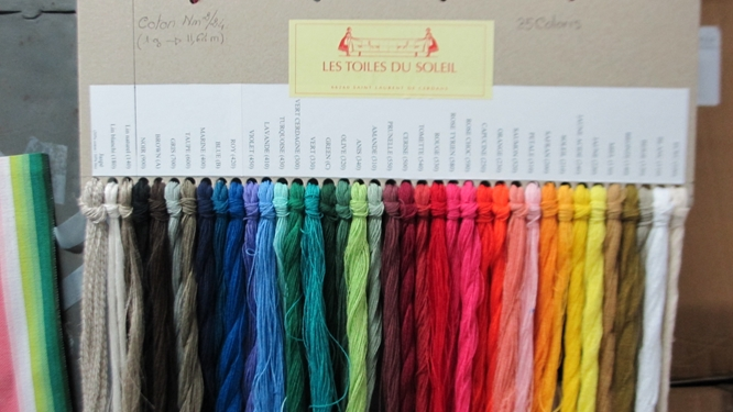 The 38 colors of threads used to make all the colorways at Les Toiles du Soleil Photo Travellati Tours.jpg
