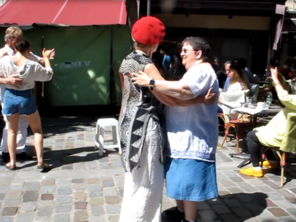 Our guest, Pam (right), dancing with a local at the weekly Bal Musette in the Latin Quarter in Paris. Photo Elizabeth Kemble.