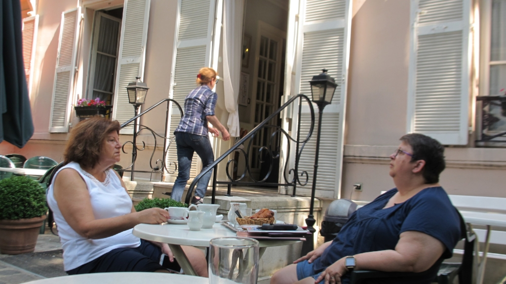 Pam (right) and Sandy having breakfast in the garden of our hotel in the heart of the Latin Quarter in Paris. Photo Travellati Tours.