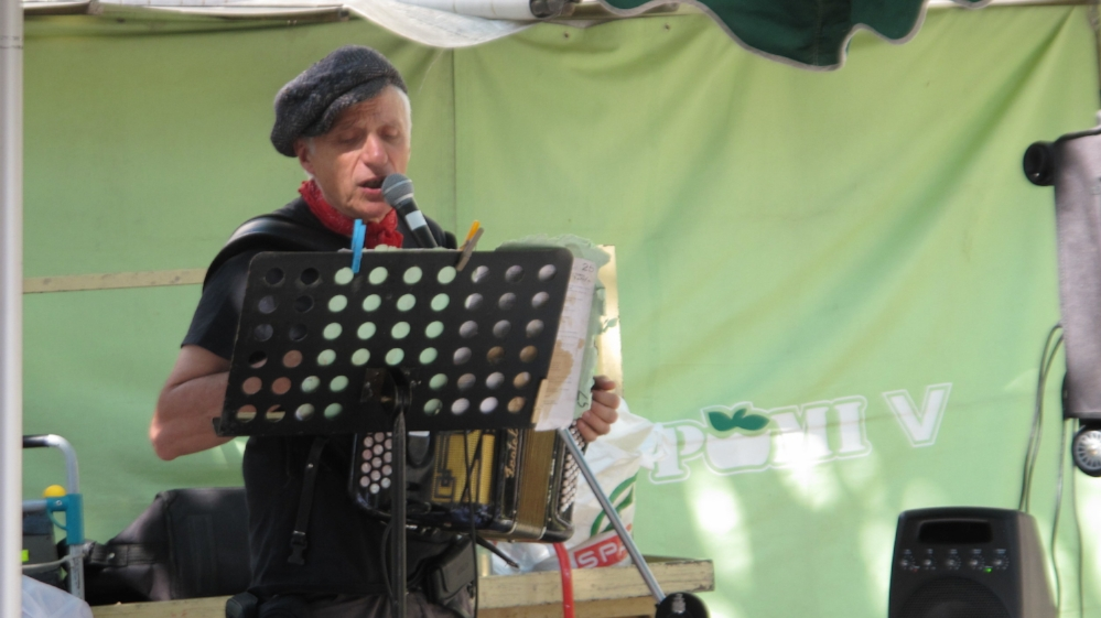 """Christian Bassoul playing accordion at his weekly """"Bal Musette"""" at the Square Saint-Medard in the Latin Quarter of Paris. Photo Elizabeth Kemble."""