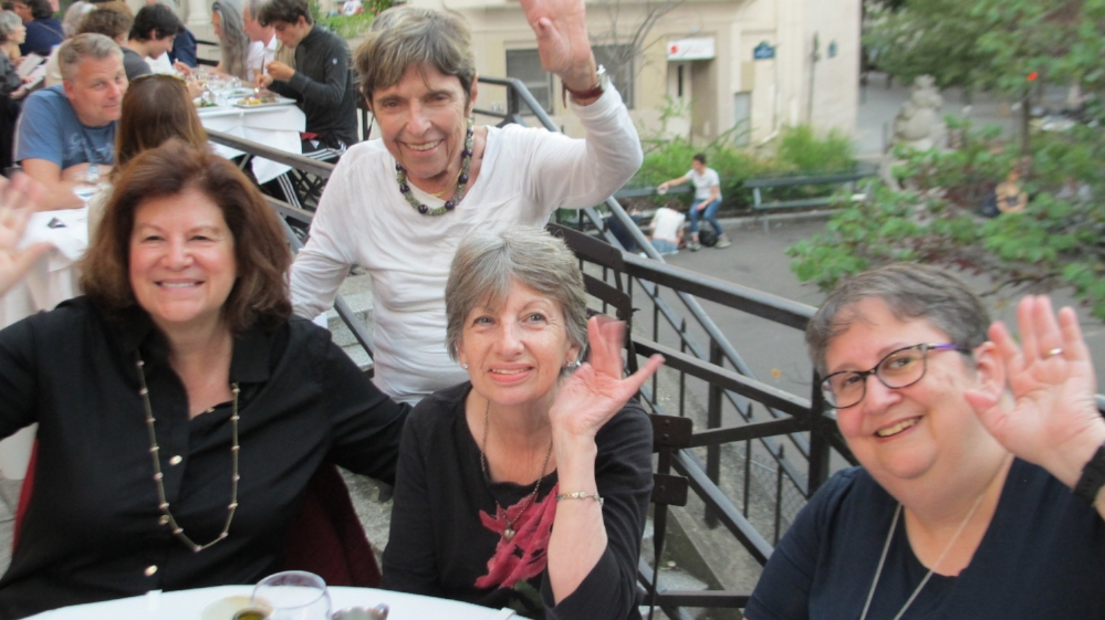 Guests at our welcome dinner on a terrace in the Latin Quarter of Paris.   Photo Travellati Tours.
