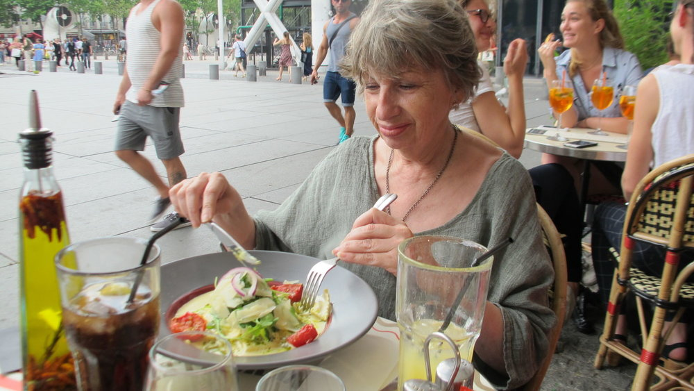 "A guest enjoying a salad at a café near ""Beaubourg,"" The Museum of Modern Art."