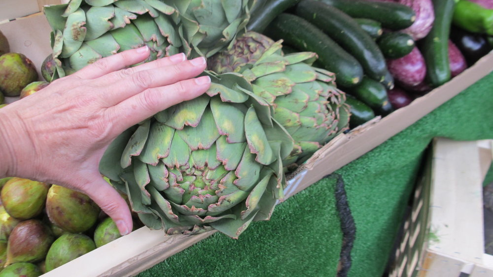 Giant artichokes at a local green market near the Bastille, Paris.