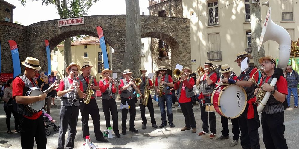 "A classic  banda  in front of the ""Pinyodrome"" in Céret where the cherry pitting and spitting contests take place during the Cherry Festival."