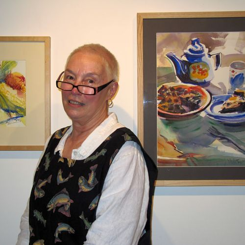 "Alix Hallman Travis with her work ""Teapot with Blueberrie Pie"" at the Longyear Gallery, Margaretville, NY."