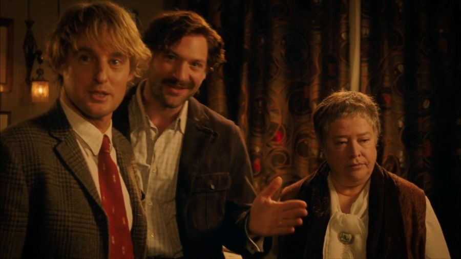 Still from  Midnight in Paris  with Owen Wilson as befuddled writer Gil Pender, Corey Stoll as Ernest Hemingway, and Kathy Bates as Gertrude Stein.
