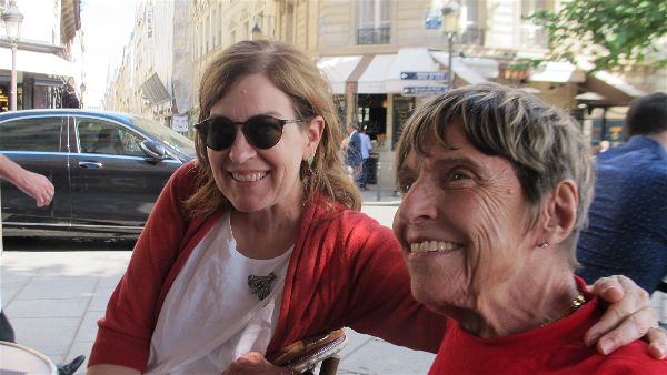 Travellati Tours guest Marietta (right) with a new friend at a café on the Ile Saint Louis, Paris, June 2017. Photo Travellati Tours.