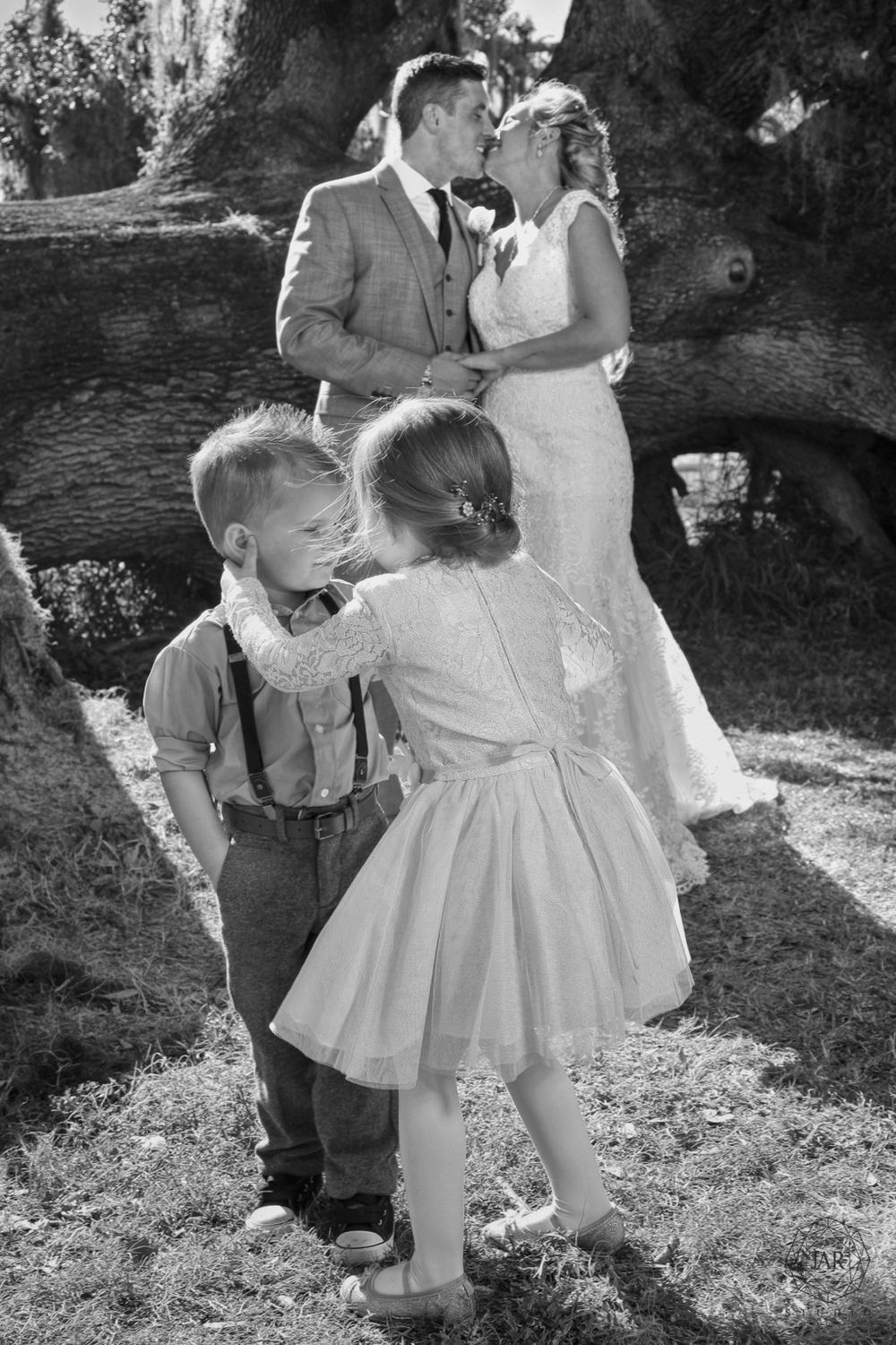 17-kids-kissing-flower-girl-dress-fun-wedding-jarstudio.JPG