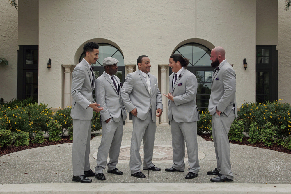 21-groomsmen-gray-tuxedos-purple-courtyard-jarstudio.JPG