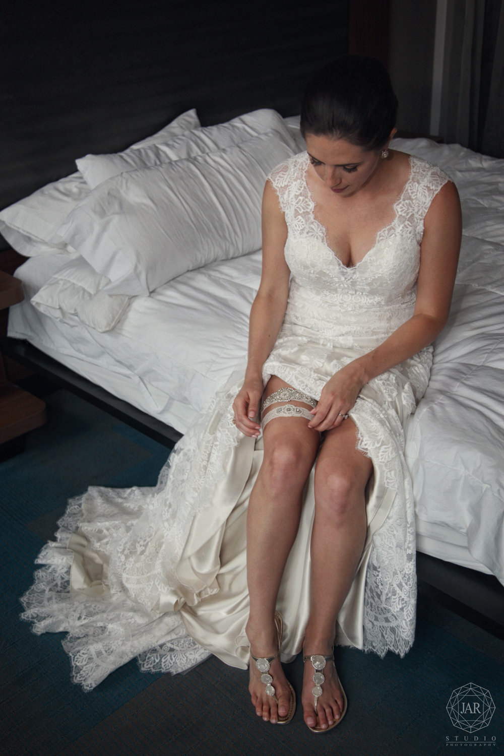 05-bride-wedding-day-getting-ready-beautiful-garter-sandals-jarstudio-photography-orlando.JPG