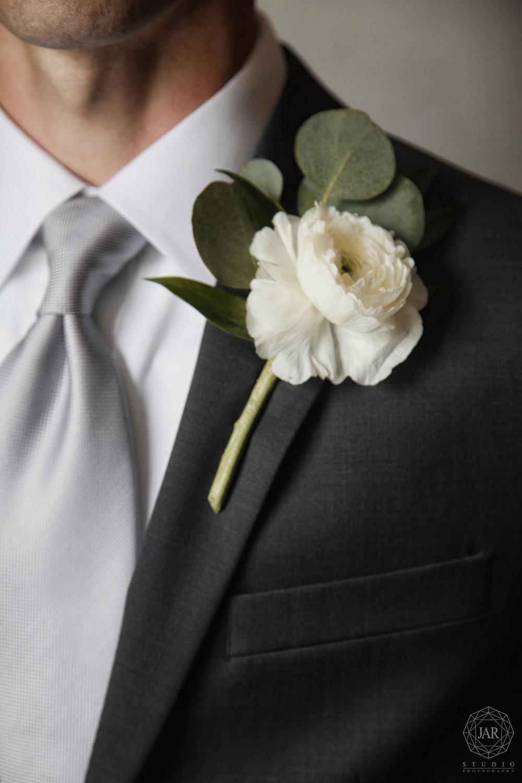 09-white-ranunculus-and-eucalyptus-grooms-boutonniere-jarstudio-orlando-photographer.JPG