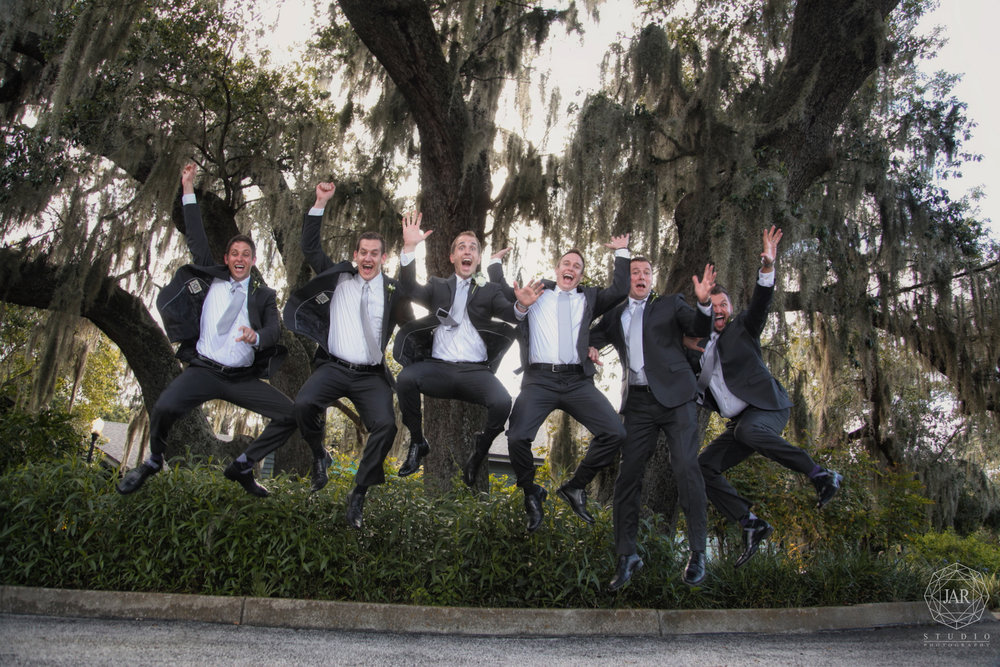 11-groom-groomsmen-jumping-for-joy-jarstudio-dubsdread-photography.JPG