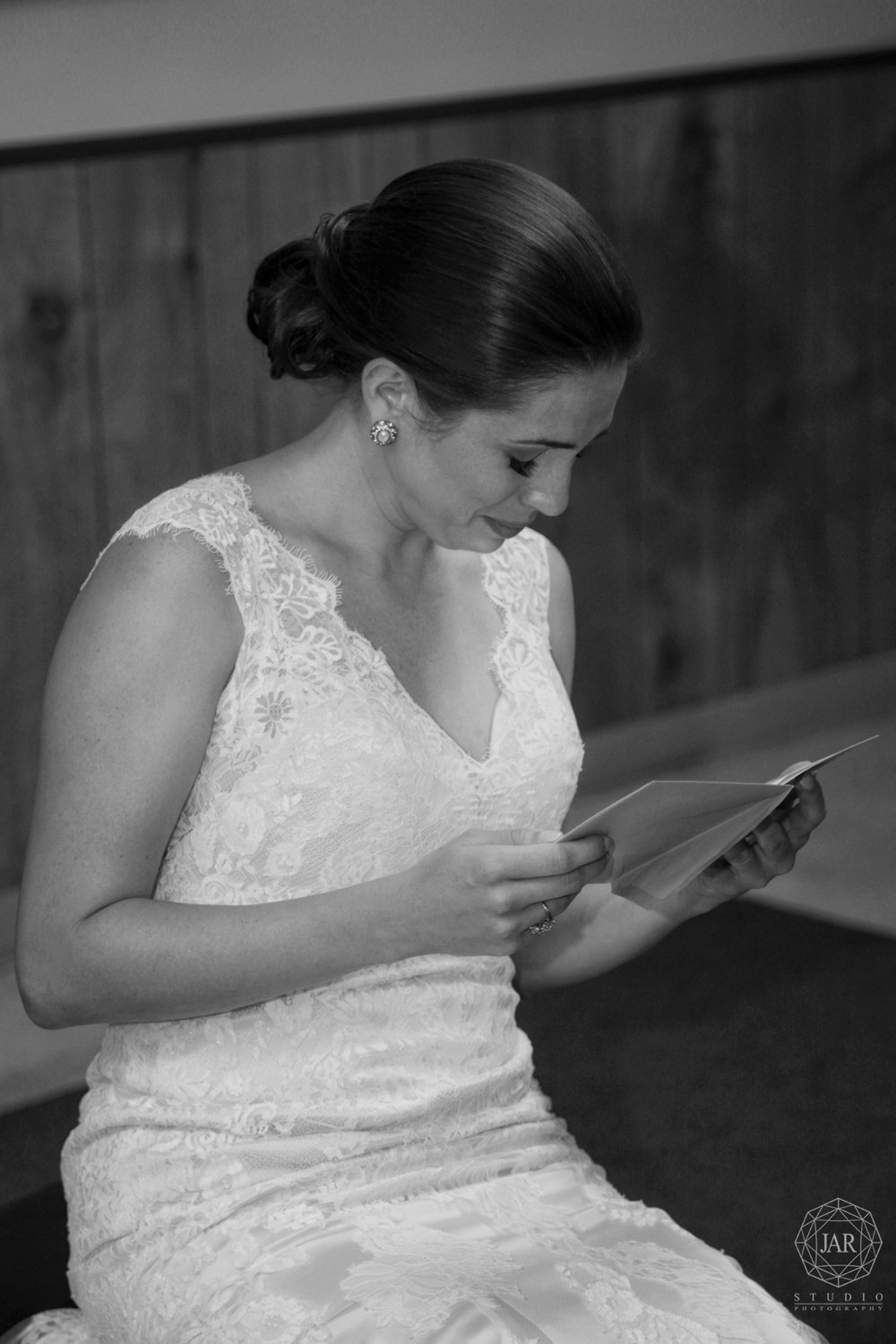 13-bride-reading-grooms-beautiful-message-jarstudio-photography.JPG