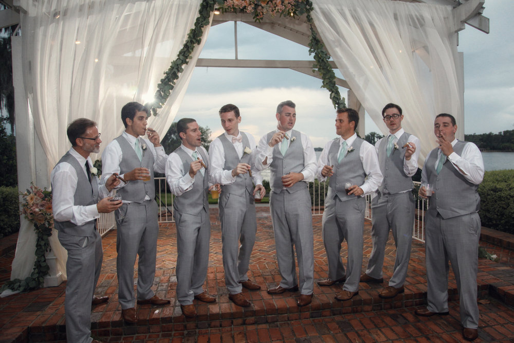 Fun groom groomsmen with cigars orlando photography