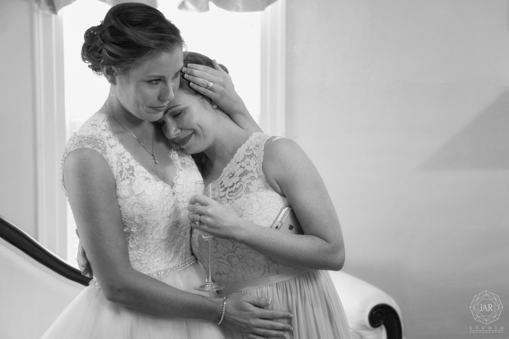 Cute bride and sister moment Orlando wedding photographer