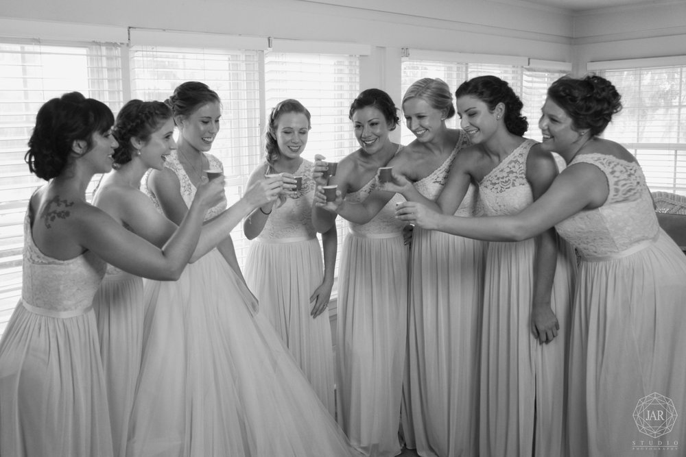 bride bridesmaids doing shots fun orlando photographer