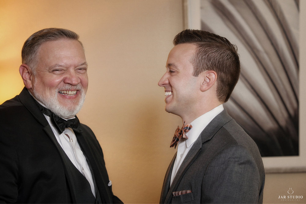 12-groom-and-dad-fun-moment-before-ceremony-fun-jarstudio-photographer-orlando.JPG