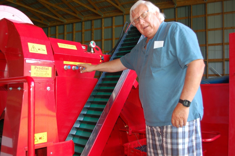 Basil Ciepliski with the berry harvester