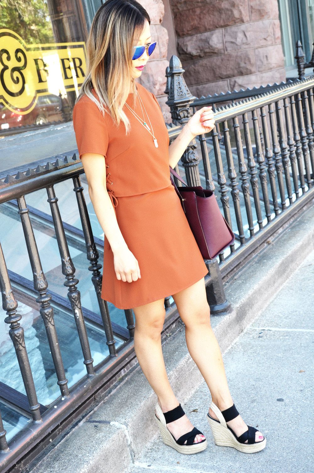 Rust Side-tie dress from  Proper  boutique in Minneapolis, Steve Madden canvas wedges (old) similar  here  and  here ,  RayBan Original 58mm Aviators in the Mirrored Lens Gold/Blue , Kate Spade cedar street hayden bag in burgundy (no longer available) similar  here , Banana Republic layered necklace (old) similar  here