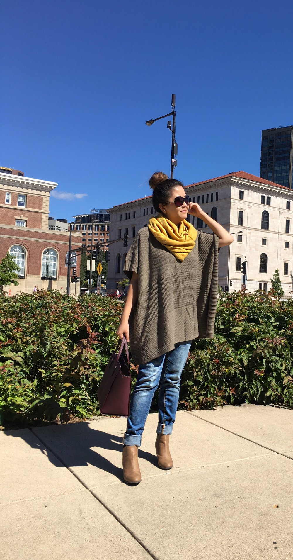 Top: Boatneck poncho similar here; Shoes: Suede ankle booties similar here