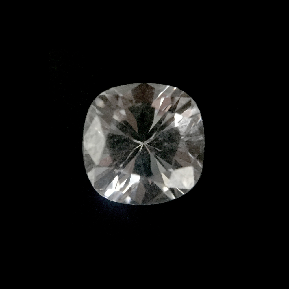 Cushion Cut  A mix between the round and princess cut, the cushion cut is a softer and more feminine diamond shape. The way in which the diamond is cut also ensures that the cushion cut, when compared with other diamond shapes, has the most fire (play of light into different colours).