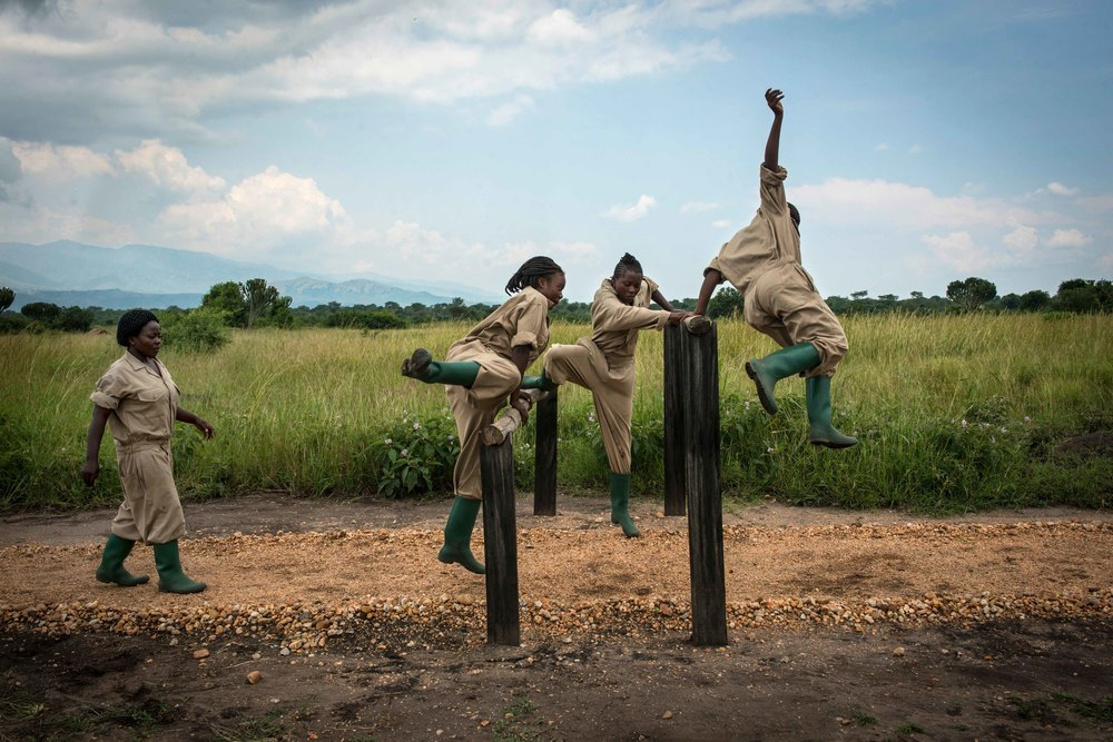 Female Rangers-in-Training complete the obstacle course, and each rangers time is posted in the mess hall.