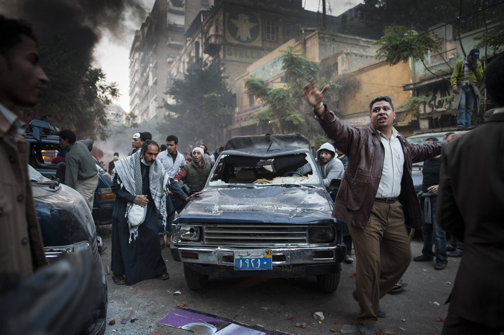 Protesters trash a police vehicle as a sign of the distrust of the government and violence inflicted by police members in Cairo, Egypt.