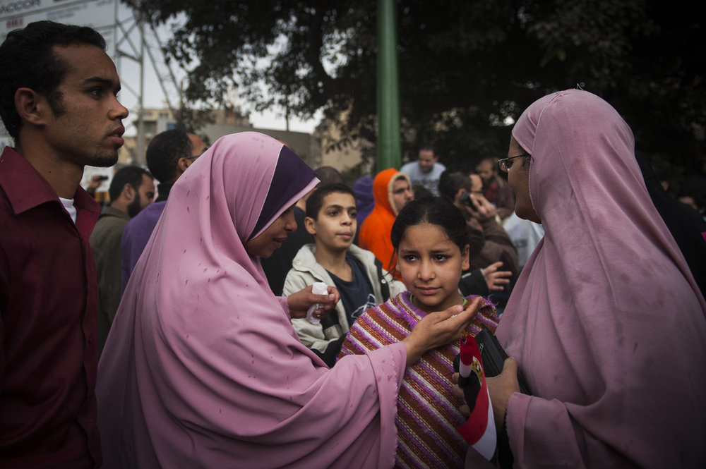 A girl cries during a protest in Tahrir Square as rain falls. Egyptians, after centuries of living in the desert, believe that rainfall is a sign from God.