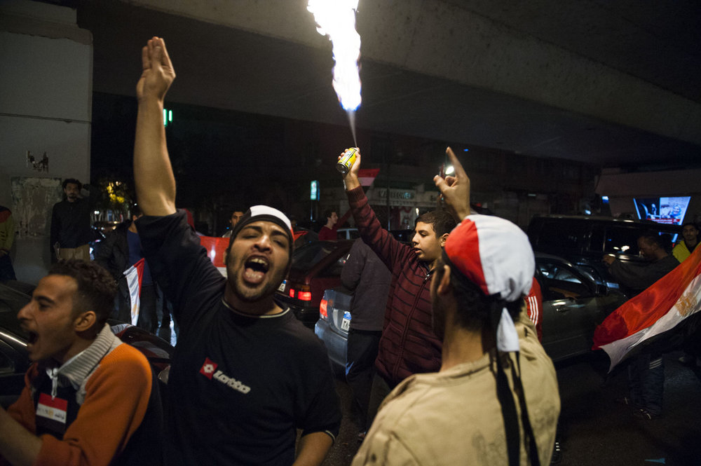 Egyptians celebrate after receiving the news that President Mubarak has stepped down after 30 years as head of Egypt.