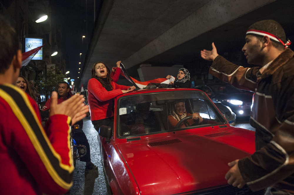 A car full of women and Egyptians celebrate under the 16th of July bridge in Zamalek, Cairo after President Mubarak announced his resignation on February 11,2011 resulting in the success of eighteen days of protest.