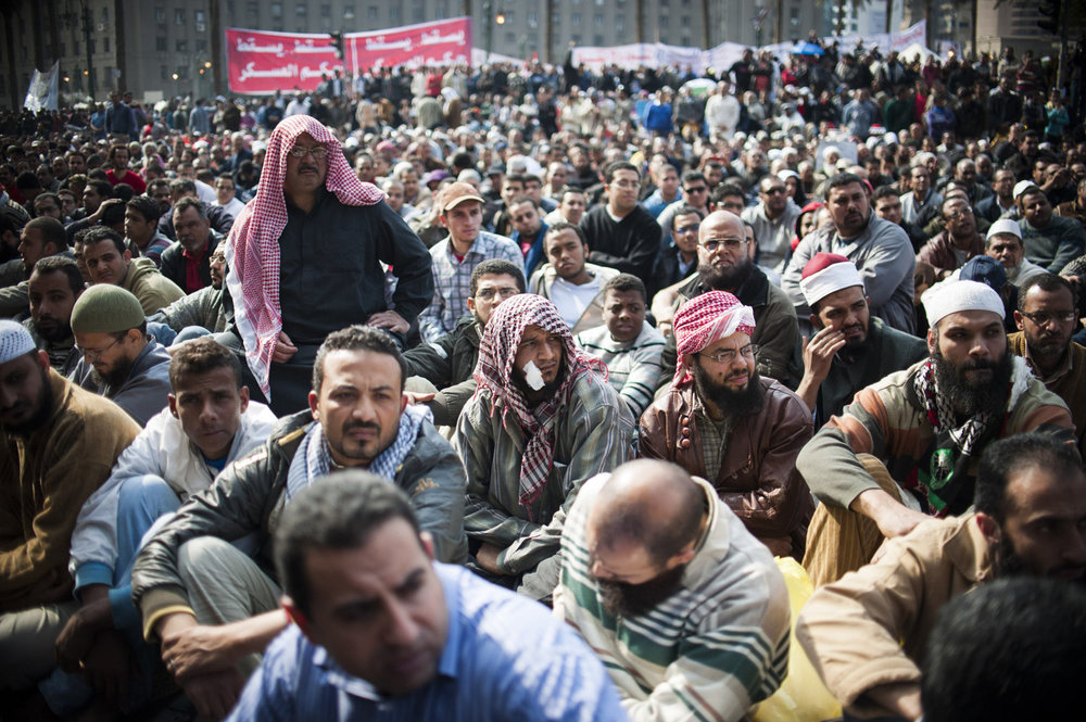 Men listen during Friday's prayers in Tahrir Square on November 25th, 2011.