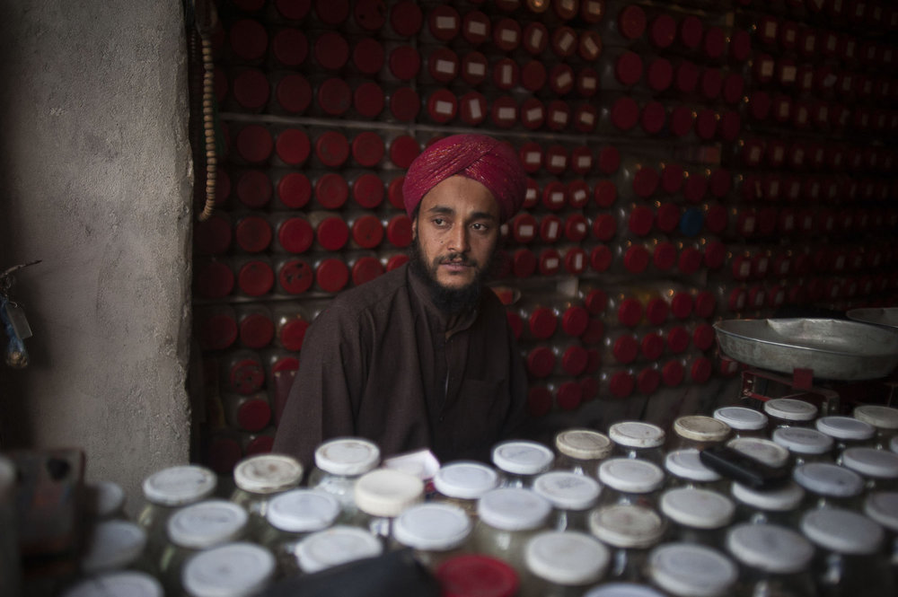 A sikh medicine man in his shop in downtown Kabul, Afghanistan.