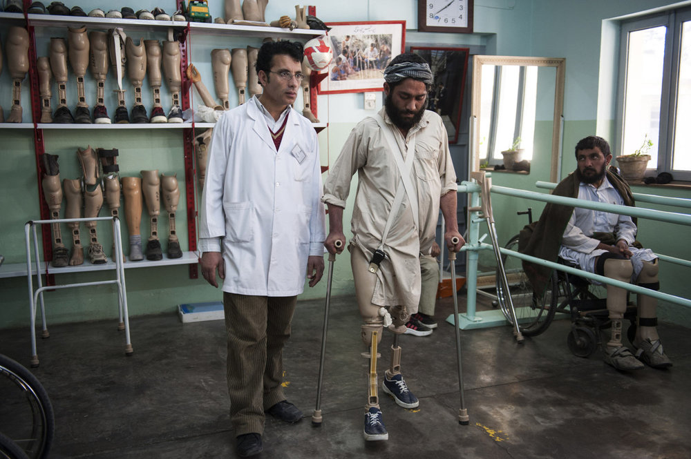 Osman Ali tests out his new prosthetic legs at the International Center for the Red Cross in Herat, Afghanistan. Osman lost both of his legs after stepping on a landmine in 2008 but can now walk for a short time.
