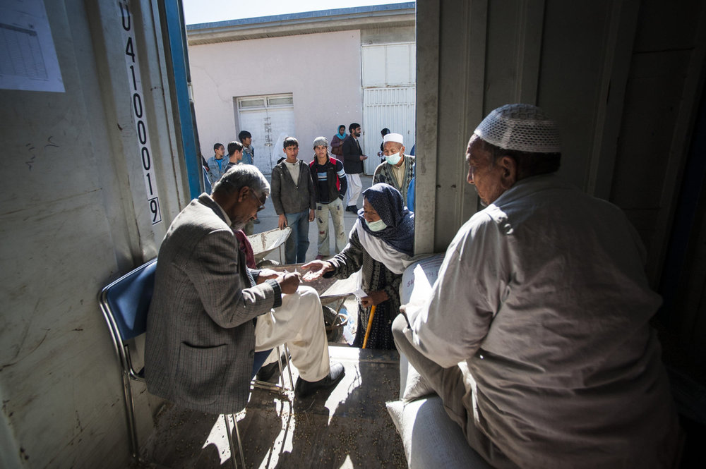 Patients with tuberculosis line up for corn rations donated by the World Food Program as an incentive to return to the treatment centure daily for treatment. The World Health organization in conjunction with the UN funds the Darliman TB clinic in Darliman, Kabul.