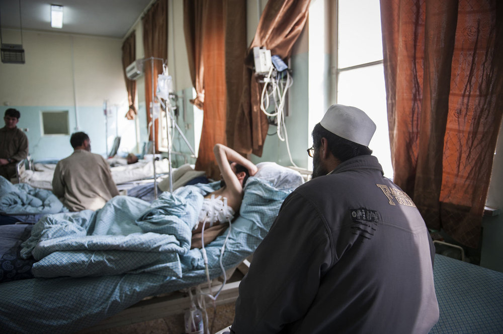 Mohammed Kabir rests in the Mens Ward of Wazir Akbar Khan Hospital in Kabul Afghanistan. Kabir suffered from a car accident several days ago and survived despite serious internal injury. He is being attended to by his brother who is also living in the hospital.