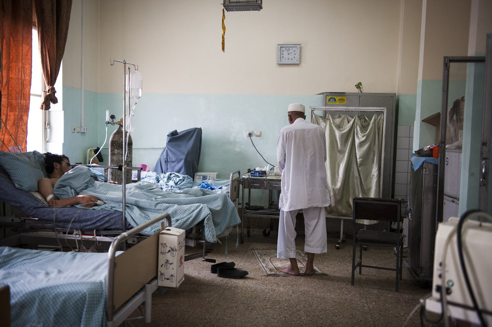 Haji Abdul Salam prays in the Mens ward of Wazir Akbar Khan Hospital. Salam recently had an operation to remove his liver stones. He traveled over 100 km from his home province of Logar, to Kabul which is the nearest hospital.