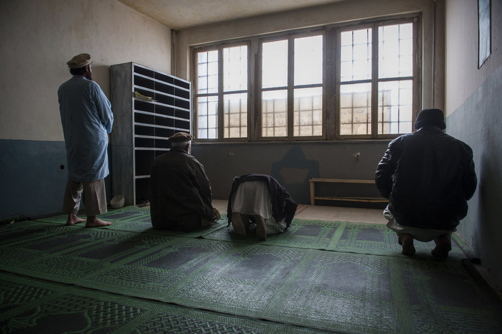 Recovering addicts in the Jangaland clinic  pray at midday. Religion is emphasized as a large part of the healing process  and recovering from their pasts. Kabul, Afghanistan.