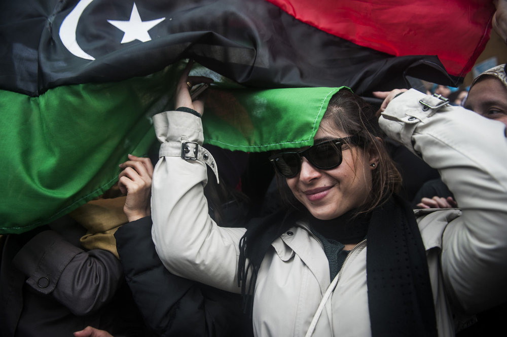 Libyans gather in the main square of Benghazi, Libya to celebrate the cities overthrow of Col. Gaddafi's 41 year rule. Cities in the east of Libya have all fallen to the resistance forces and efforts to sent up a temporary government are in action.