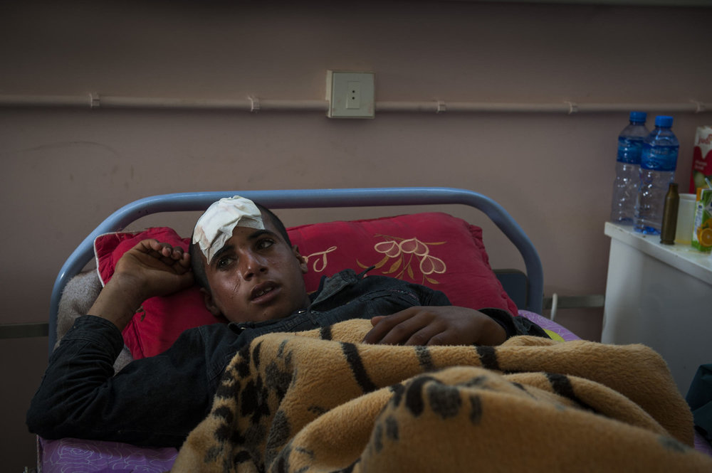 A young boy, injured yesterday in the fighting, cries as he recounts what happened to him in Brega Hospital, in Brega Libya