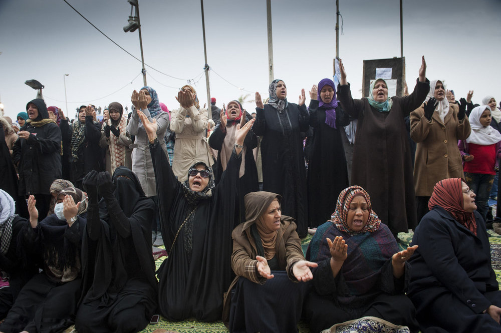 Groups of women pray during Friday Prayers in front of  Benghazi's downtown courthouse, men and women pray for safety and for the end of Gaddafi's reign. After a violent battle, the resistance members in Benghazi overtook city and set up an interim government based in the new capital of Benghazi.