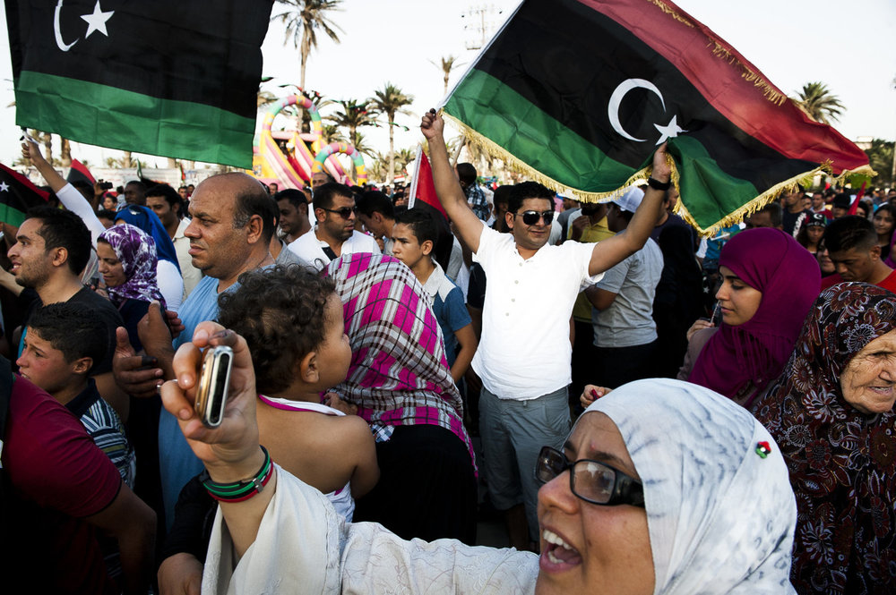 Libyans celebrate after voting. After 42 years of Muammar Gaddafi's reign, Libyans are participating in the first democratic election since 1969. Calls for boycott and election violence threatens the momentous day as campaigning drew to a close the day before the July 7th election.